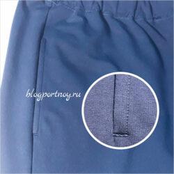 Процесс пошива кармана в шве на спортивных брюках